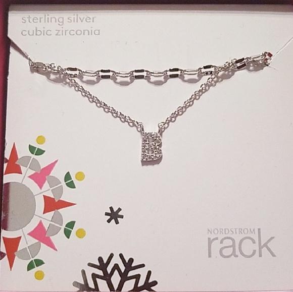 f3f3e4e65 Sterling silver cubic zirconia initial necklace. M_5b73586d1b329464ac7c42ba